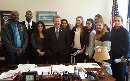 Senator William Stanley and students